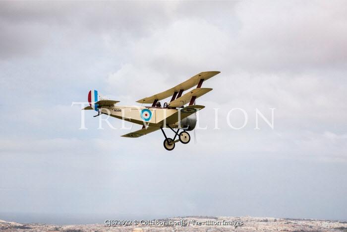 CollaborationJS World War I aeroplane flying over cliffs Miscellaneous Transport