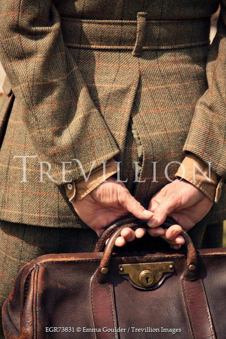Emma Goulder RETRO WOMAN IN TWEED COAT HOLDING BAG Women