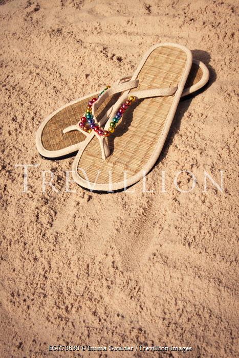 Emma Goulder RAFFIA FLIP FLOPS ON SANDY BEACH Miscellaneous Objects