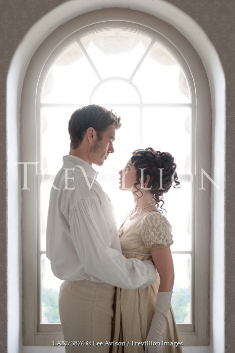 Lee Avison regency couple embracing beneath arched window Couples