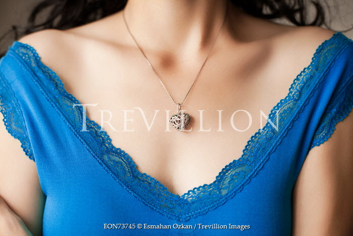 Esmahan Ozkan WOMAN WEARING BLUE TOP AND NECKLACE Women