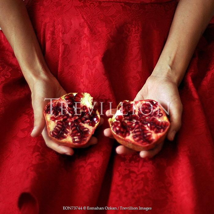 Esmahan Ozkan WOMAN IN RED DRESS HOLDING POMEGRANATE FRUIT Women
