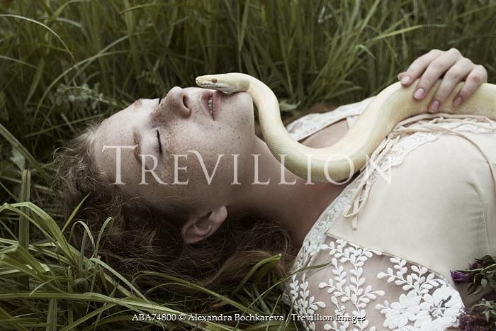 Alexandra Bochkareva YOUNG WOMAN WITH SNAKE LYING ON GRASS Women