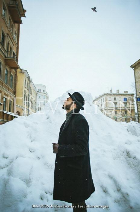 Irina Brana MAN WITH BEARD AND HAT BY SNOW DRIFT IN CITY Men