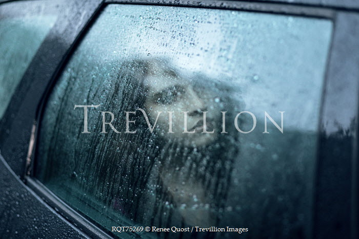 Renee Quost YOUNG WOMAN INSIDE CAR WITH RAINY WINDOW Women