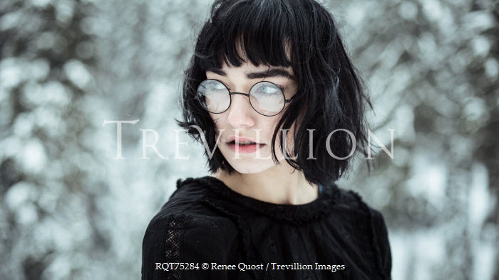 Renee Quost YOUNG WOMAN WEARING GLASSES IN SNOWY COUNTRYSIDE Women