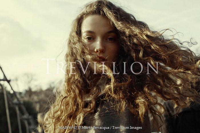 Trevillion Images Marta Bevacqua Windswept Woman With Dark Wavy Hair Pe8