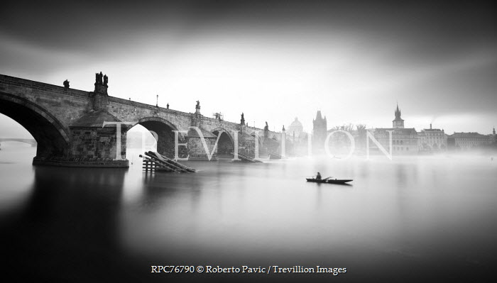 Roberto Pavic BOAT ON RIVER BY TOWN Specific Cities/Towns