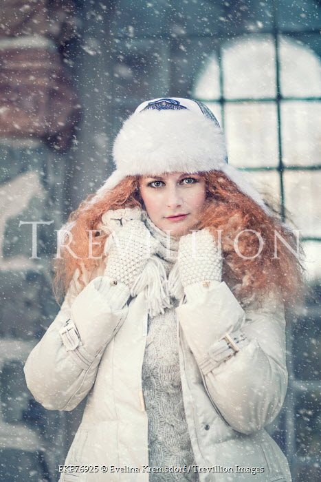 Evelina Kremsdorf YOUNG WOMAN WEARING FURRY HAT IN SNOW Women