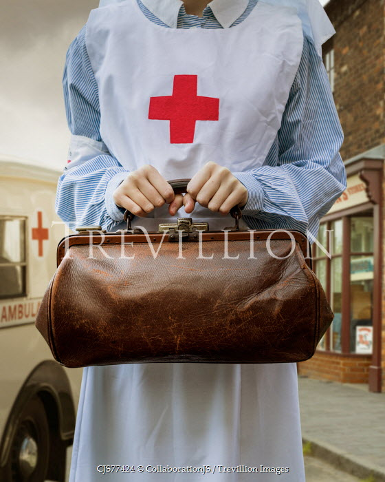CollaborationJS A 1940s nurse holding up a bag Women