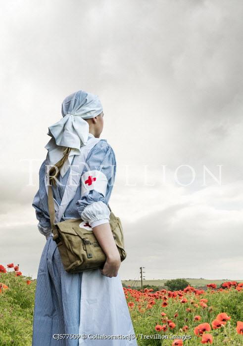 CollaborationJS ww2 nurse standing in poppy field Women
