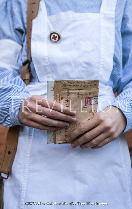 CollaborationJS German ww2 nurse holding letter Women