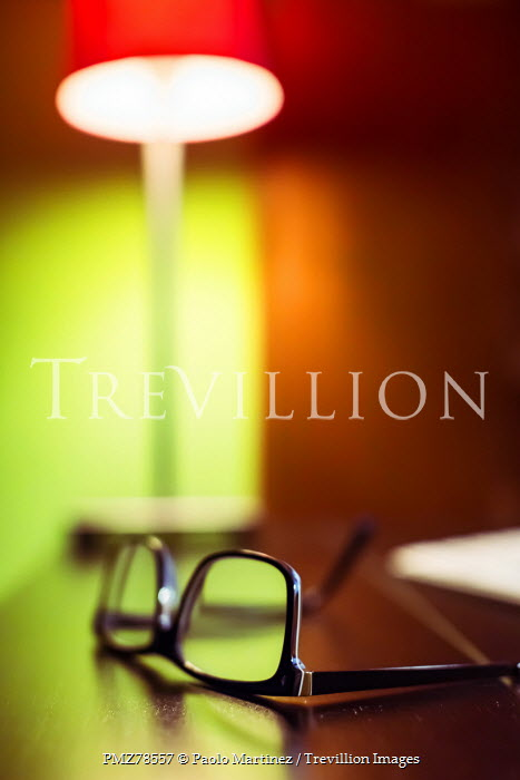 Paolo Martinez PLASTIC SPECTACLES ON DESK BESIDE LAMP Miscellaneous Objects
