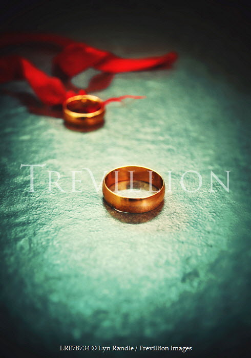 Lyn Randle TWO GOLD WEDDING RINGS BY RED RIBBON Miscellaneous Objects