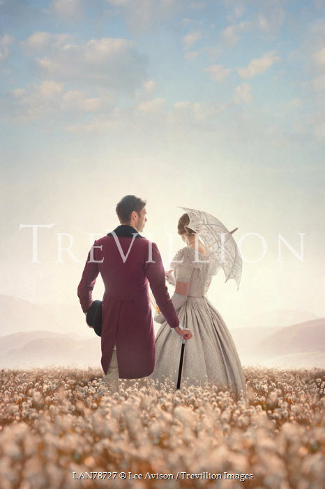 Lee Avison victorian couple standing in a meadow Couples