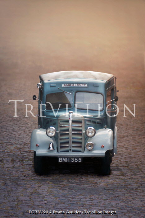 Emma Goulder VINTAGE AMBULANCE ON COBBLED STREET Miscellaneous Transport