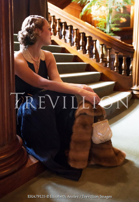 Elisabeth Ansley YOUNG VINTAGE WOMAN SITTING ON GRAND STAIRCASE Women