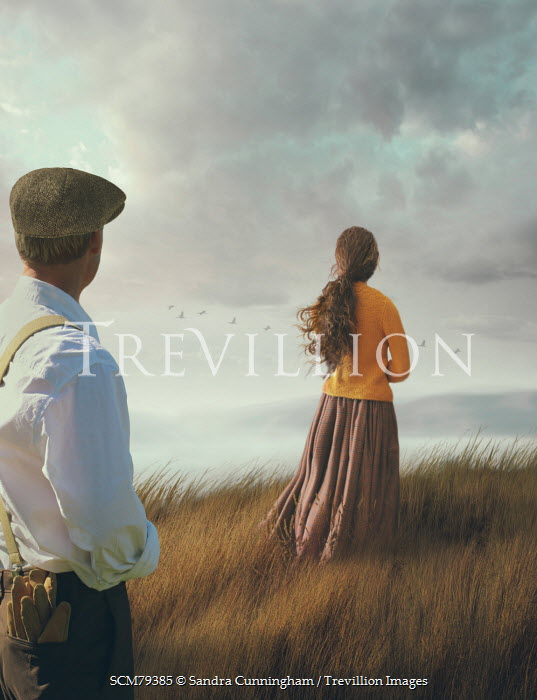 Sandra Cunningham VINTAGE COUPLE STANDING APART ON CLIFF TOP Couples