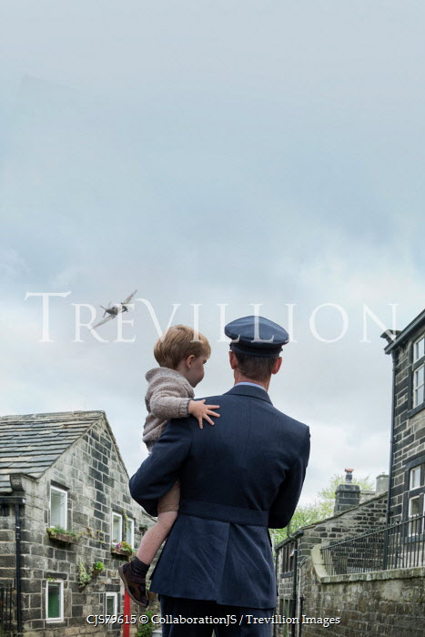 CollaborationJS A RAF officer holding his young son Men