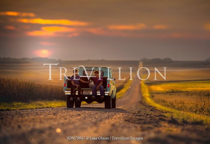 Jake Olson TWO MEN ON TRUCK IN COUNTRYSIDE Men