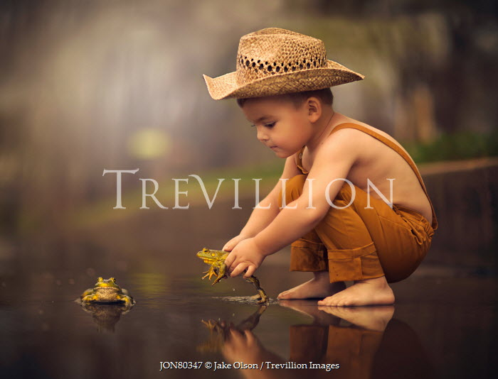 Jake Olson LITTLE BOY PLAYING WITH FROGS Children