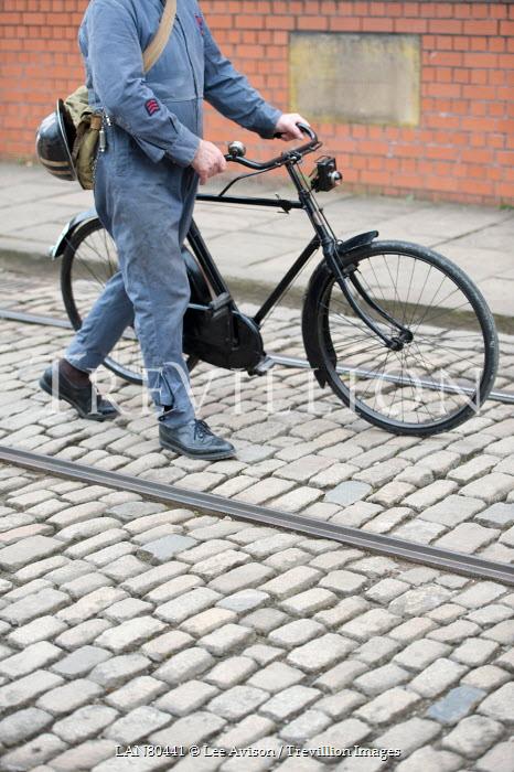 Lee Avison 1940s MAN IN OVERALLS PUSHING BICYCLE Men