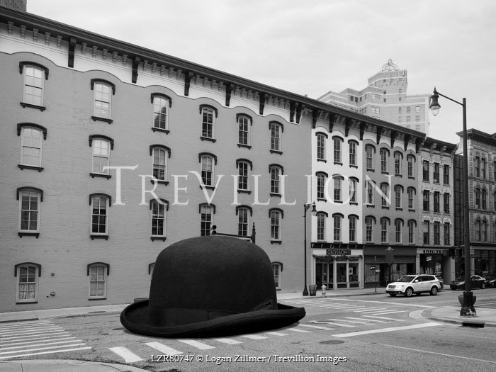 Logan Zillmer SURREAL GIANT BOWLER HAT ON CITY STREET Specific Cities/Towns