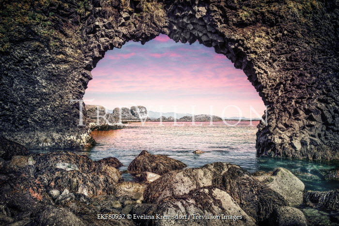 Evelina Kremsdorf sea and sunset through archway of rocks Seascapes/Beaches