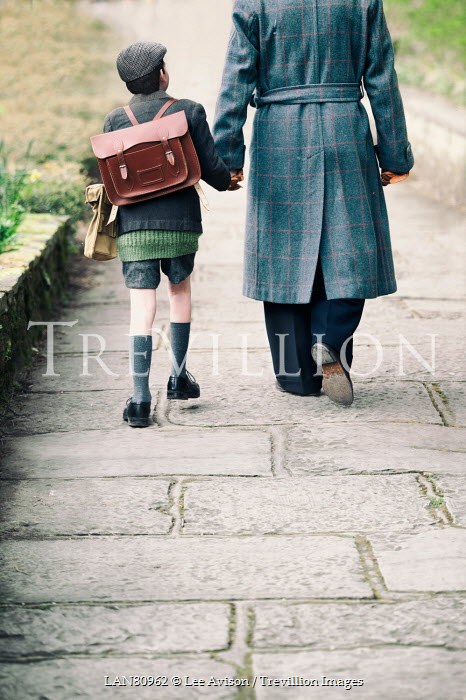Lee Avison 1940s father and son walking down path Groups/Crowds