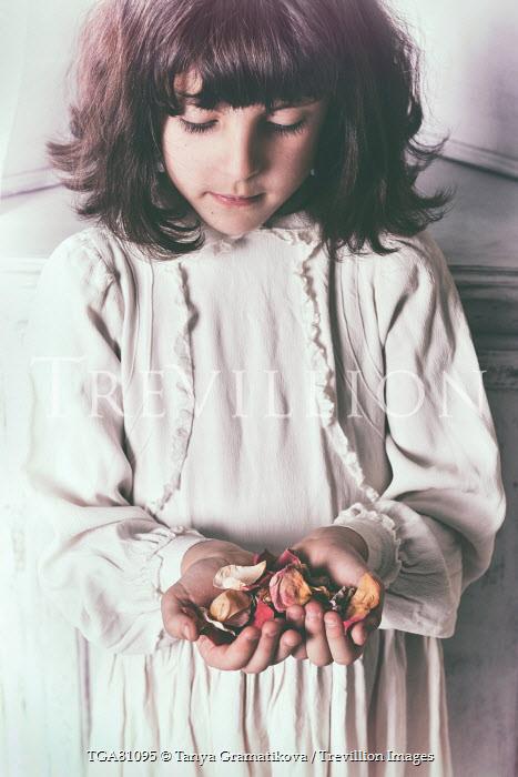 Tanya Gramatikova LITTLE BRUNETTE GIRL HOLDING FLOWER PETALS Children