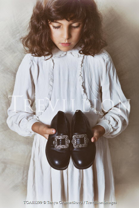 Tanya Gramatikova LITTLE BRUNETTE GIRL HOLDING BUCKLED SHOES Children