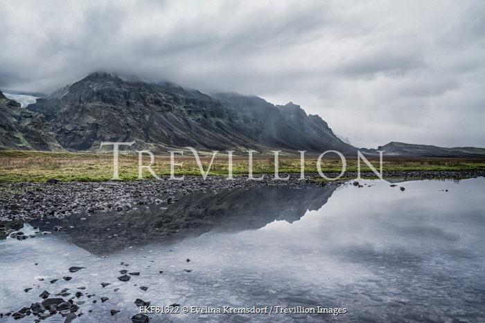 Evelina Kremsdorf CLOUDY MOUNTAINS REFLECTED IN LAKE Rocks/Mountains