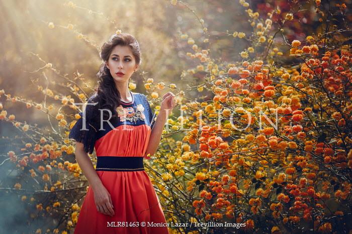 Monica Lazar WOMAN IN GARDEN WITH ORANGE FLOWERS Women