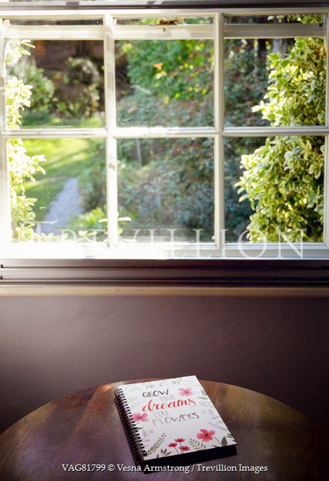 Vesna Armstrong NOTEBOOK ON TABLE BY GARDEN WINDOW Interiors/Rooms