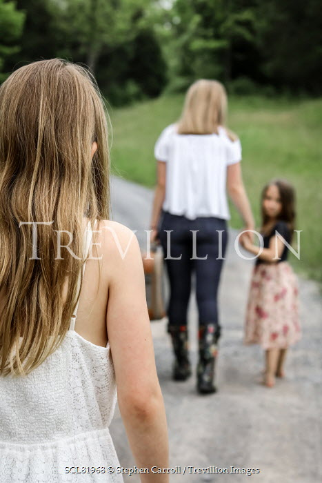 Stephen Carroll GIRL WALKING BEHIND MOTHER AND SISTER IN PARK Groups/Crowds