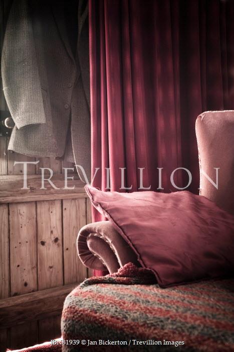 Jan Bickerton armchair and jacket on door inside cottage Interiors/Rooms