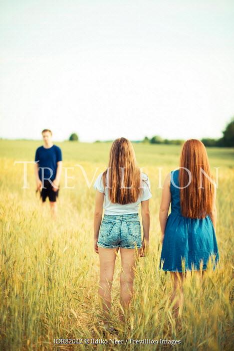Ildiko Neer TEENAGE GIRLS AND BOY IN WHEAT FIELD Groups/Crowds