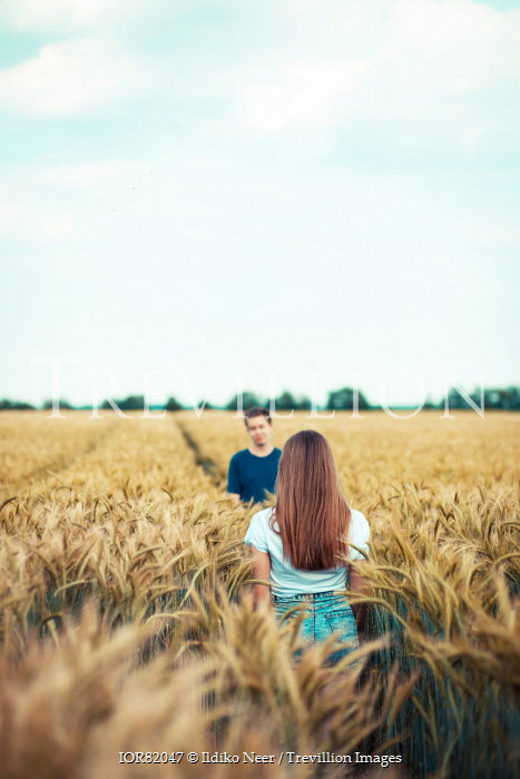 Ildiko Neer modern teenage couple in wheat field Couples