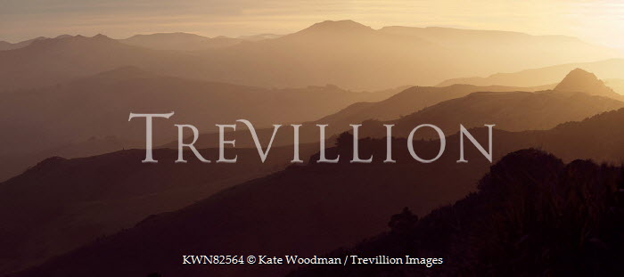 Kate Woodman MISTY MOUNTAINS AT SUNSET Rocks/Mountains