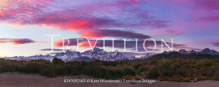 Kate Woodman SNOWY MOUNTAINS AND DESERT UNDER PINK SKY Rocks/Mountains
