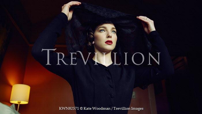 Kate Woodman YOUNG GLAMOROUS 1950S WOMAN WEARING BLACK Women