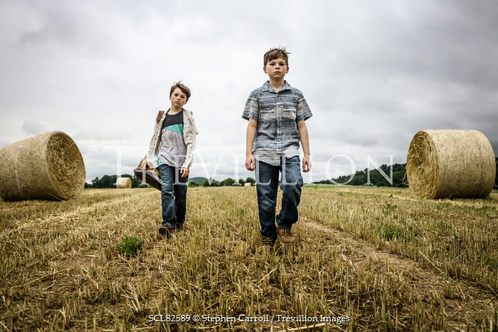 Stephen Carroll YOUNG BOYS WALKING BY HAY BALES Children