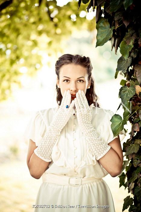 Ildiko Neer Young retro brunette woman in summer garden Women