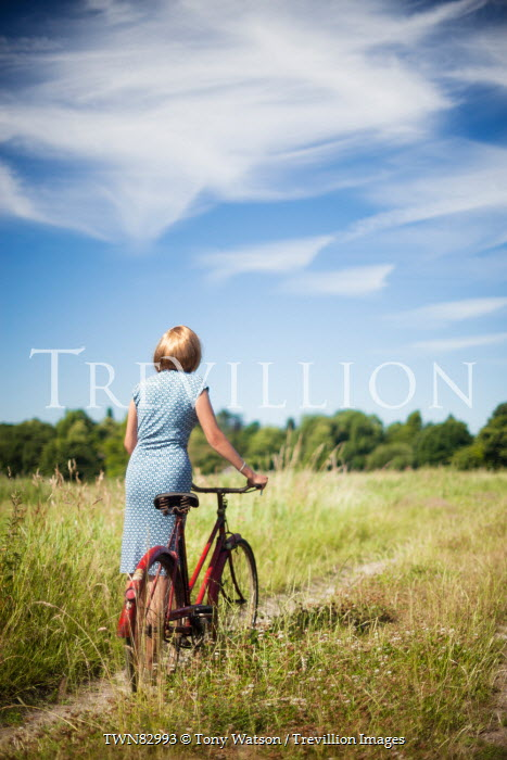 Tony Watson BLONDE WOMAN WITH BICYCLE IN COUNTRYSIDE Women
