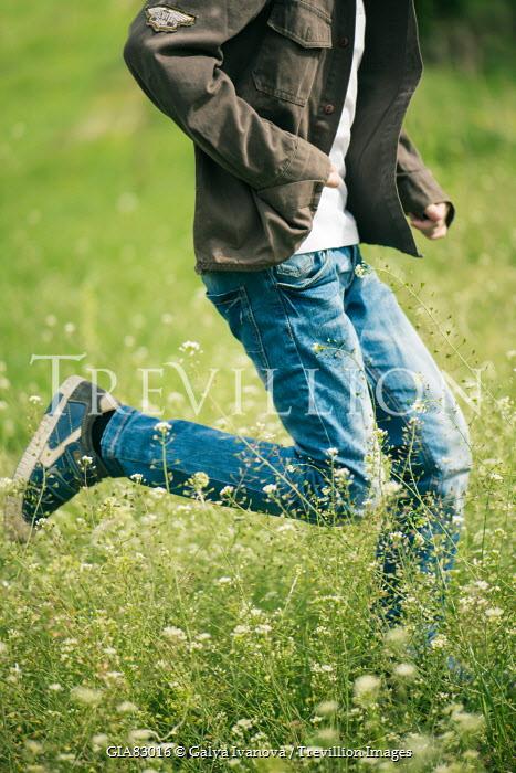 Galya Ivanova YOUNG MODERN MAN RUNNING IN FIELD Men