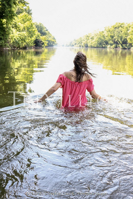 Stephen Carroll YOUNG WOMAN WADING IN COUNTRY LAKE Women