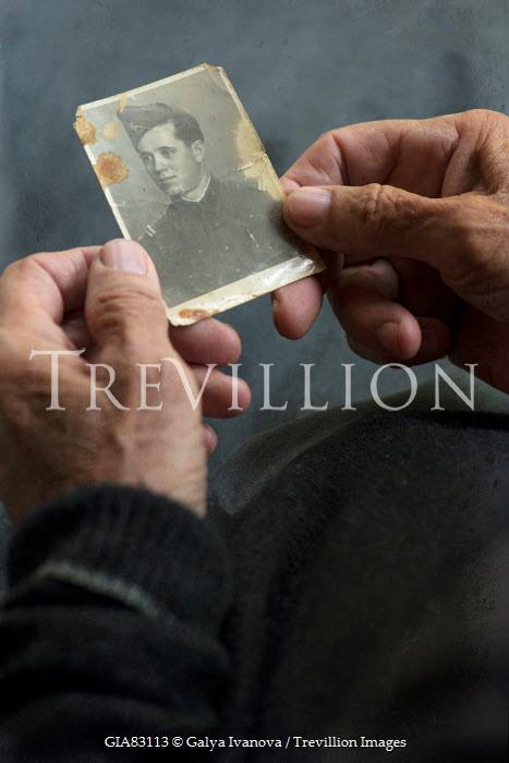 Galya Ivanova OLD MAN HOLDING PHOTO OF WARTIME OFFICER Body Detail