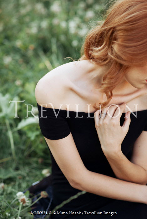 Muna Nazak YOUNG RED HAIRED WOMAN SITTING ON GRASS Women