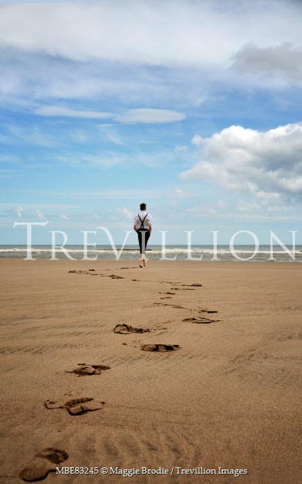 Maggie Brodie RETRO MAN LEAVING FOOTPRINTS ON SANDY BEACH Men