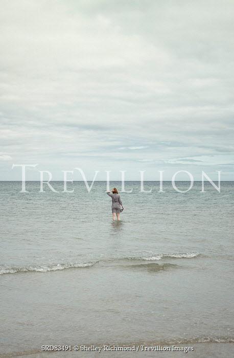 Shelley Richmond YOUNG WOMAN WADING IN CLOUDY SEA Women